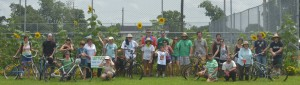 Urban Farm Bike Tour participants pose outside of the Federal City Community Garden